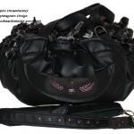 Heavy Metal - Rueckseite - LederArt in schwarz - Innen: Webpelz schwarz-grau meliert - Applikation: Schwalben